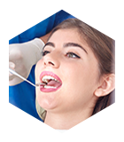 Young woman receiving dental exam