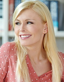 young blonde woman smiling
