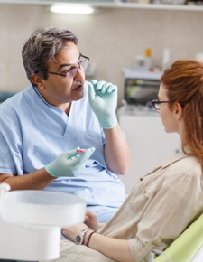 Dentist discussing treatment with dental patient