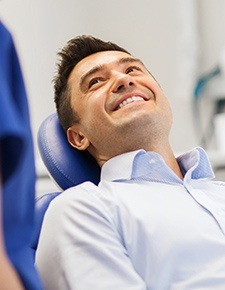 smiling man in dentist chair