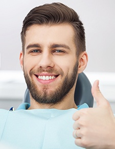 Man giving a thumbs up in the dental chair
