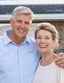 Older couple posing at home
