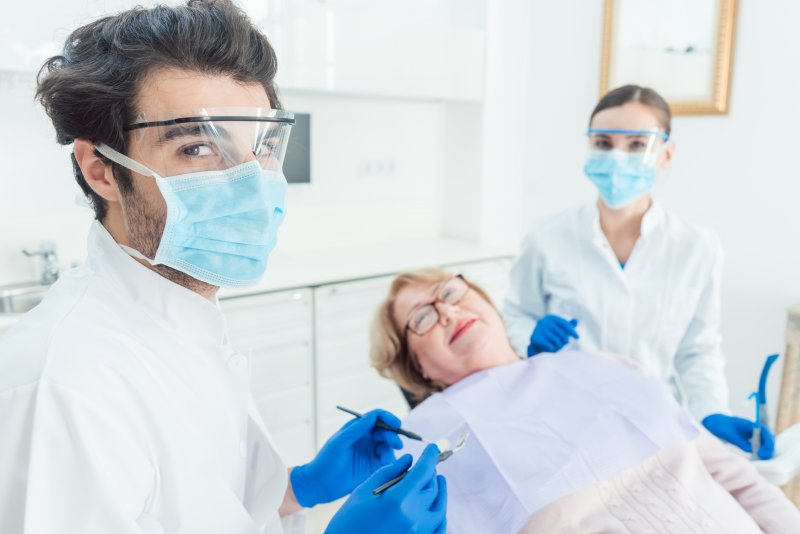 Dentist in Friendswood wearing PPE